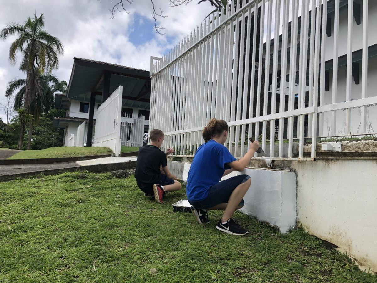 George and Hannah Campbell painting the front fence at Casa Provedencia.